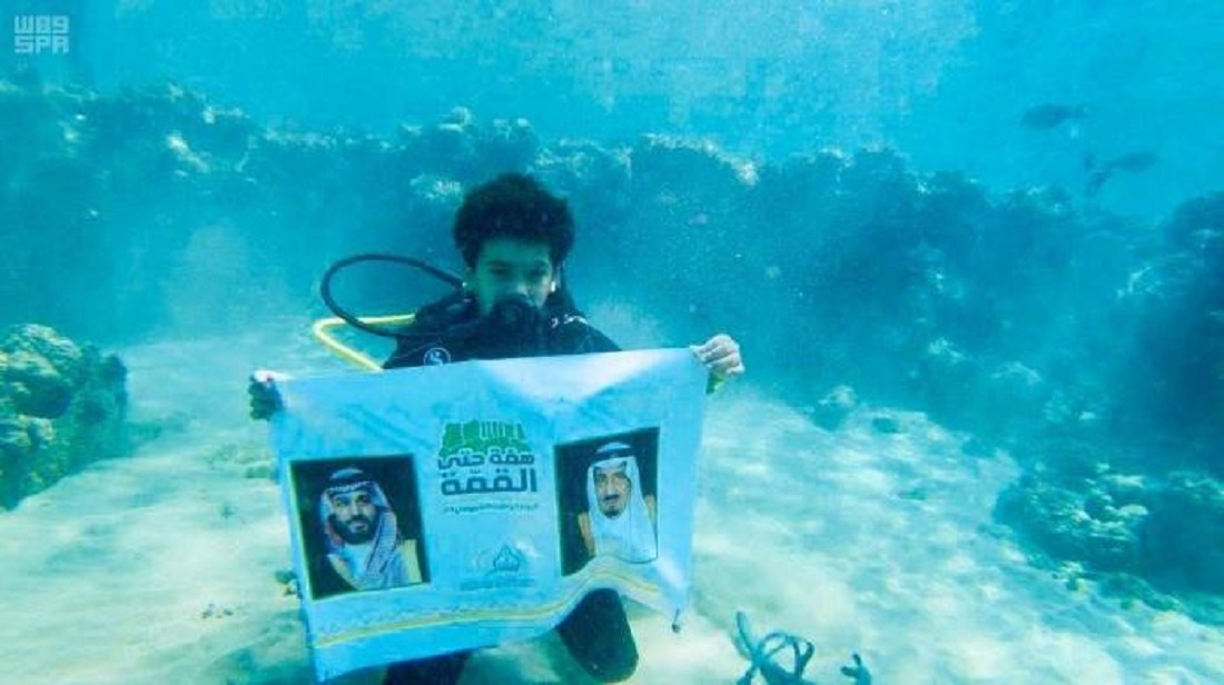Ten-year-old dives underwater to wish Saudi on National Day